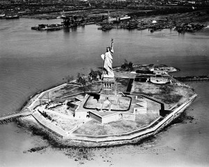 Aerial Overview of Statue and Island with part of New Jersey shoreline, 1935.
