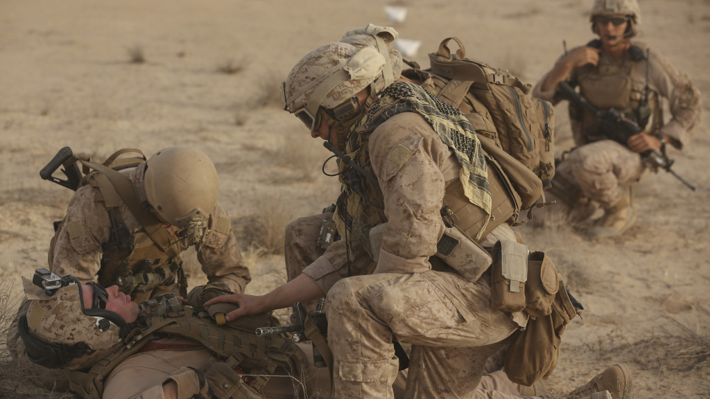 Marines and Sailors with India Company, 3rd Battalion, 7th Marine Regiment, Special Purpose Marine Air Ground Task Force – Crisis Response – Central Command, assess the condition of a simulated casualty during a tactical recovery of aircraft and personnel training exercise, May 29, 2015, in Southwest Asia. With U.S. and coalition forces conducting airstrikes in support of Operation Inherent Resolve, the TRAP forces of the SPMAGTF provide an on-call force dedicated to the safe return of the U.S. and coalition service members. (U.S. Marine Corps Photo by Cpl. Garrett D. White, CJTF-OIR Public Affairs,)